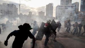 IMG by Alejandro Cegarra, Associated Press.